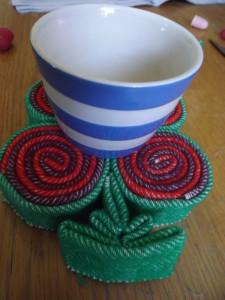 Kira's quilllie cup mat.